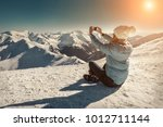 happy woman relaxing on the top ... | Shutterstock . vector #1012711144