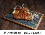 t bone steak on board   Shutterstock . vector #1012713064