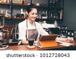 barista woman using digital... | Shutterstock . vector #1012728043