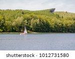sunny warm sailboat excursion | Shutterstock . vector #1012731580