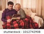 husband and wife going over old ... | Shutterstock . vector #1012742908