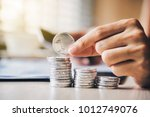 a businessman is picking up his ... | Shutterstock . vector #1012749076