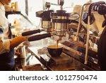 barista make coffee latte art... | Shutterstock . vector #1012750474