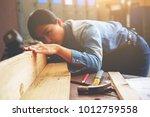 carpenter working on... | Shutterstock . vector #1012759558