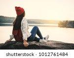 happy asian woman sitting on... | Shutterstock . vector #1012761484