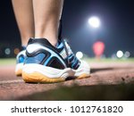 runner step on track with... | Shutterstock . vector #1012761820