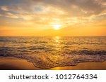 beautiful sunset on the beach... | Shutterstock . vector #1012764334