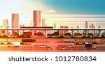 modern city over sunset... | Shutterstock .eps vector #1012780834