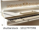 white piano  side view of... | Shutterstock . vector #1012797598