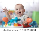 funny baby boy playing in baby... | Shutterstock . vector #1012797853