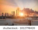 oil refinery at sunset  ... | Shutterstock . vector #1012798420