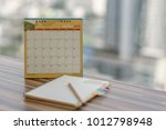 notebook with pencil diary on... | Shutterstock . vector #1012798948