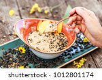 woman eating oatmeal porridge... | Shutterstock . vector #1012801174