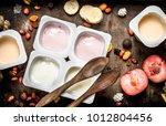 various fruit yoghurts. on a... | Shutterstock . vector #1012804456