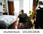senior man sitting on the... | Shutterstock . vector #1012812838