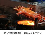 barbecued suckling pig fire... | Shutterstock . vector #1012817440