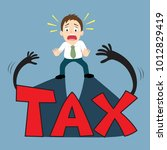 businessman scared with tax... | Shutterstock .eps vector #1012829419