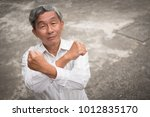 senior old man crossing arm... | Shutterstock . vector #1012835170