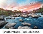 Waterfall On Mountain River...