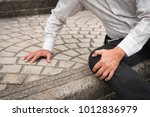 Small photo of old senior man falling down, retired senior pensioner man accident; elderly old senior man injury, old senior man falls down and breaks his leg bone or knee joint; health or accident insurance concept