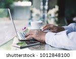 attractive business man hand... | Shutterstock . vector #1012848100