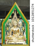 Small photo of gold buddha statue with artifact green aura behind.