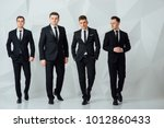 group of four men in suits... | Shutterstock . vector #1012860433