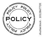grunge black policy word round... | Shutterstock .eps vector #1012867720
