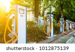 electric vehicle parking | Shutterstock . vector #1012875139