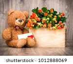 flowers and a teddy bear on... | Shutterstock . vector #1012888069