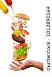 man cooking a cheeseburger.... | Shutterstock . vector #1012890364