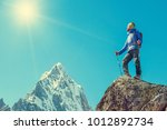 hiker with backpacks reaches... | Shutterstock . vector #1012892734