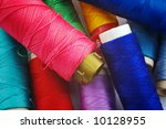 Close up of colored sewing spools - stock photo