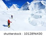 climber reaches the summit of... | Shutterstock . vector #1012896430