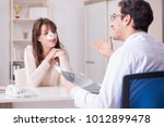 male doctor talking to patient... | Shutterstock . vector #1012899478