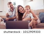 portrait of a joyful family... | Shutterstock . vector #1012909333