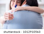 wife and husband looking at... | Shutterstock . vector #1012910563