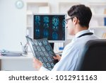 doctor radiologist looking at x ... | Shutterstock . vector #1012911163