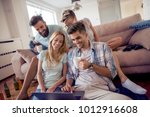 friends sitting together on the ...   Shutterstock . vector #1012916608