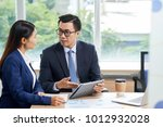 vietnamese managers discussing... | Shutterstock . vector #1012932028