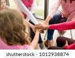 multiethnic women wearing pink... | Shutterstock . vector #1012938874