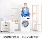 young woman sitting on washing... | Shutterstock . vector #1012939459