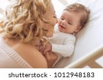 a woman with a baby | Shutterstock . vector #1012948183