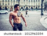 handsome muscular man with... | Shutterstock . vector #1012963354