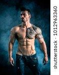 handsome shirtless muscular man ... | Shutterstock . vector #1012963360