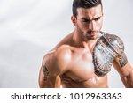 handsome shirtless muscular man ... | Shutterstock . vector #1012963363