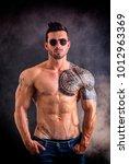 handsome shirtless muscular man ... | Shutterstock . vector #1012963369