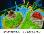 children play with kinetic sand.... | Shutterstock . vector #1012963750