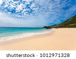 golden sand of sandy beach  o...