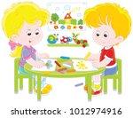 little children drawing funny... | Shutterstock .eps vector #1012974916